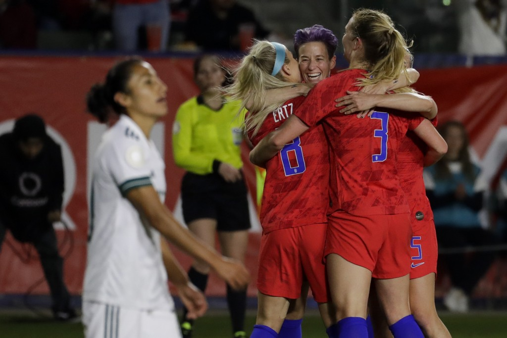 U.S. players, including Megan Rapinoe, facing camera, and Julie Ertz, left, celebrate after a goal by midfielder Samantha Mewis (3) during the first h...