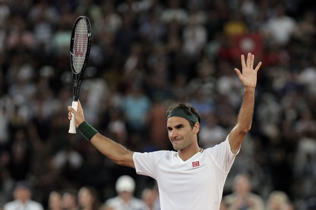 Roger Federer thanks the crowd after winning 3 sets to 2 against Rafael Nadal in their exhibition tennis match held at the Cape Town Stadium in Cape T...
