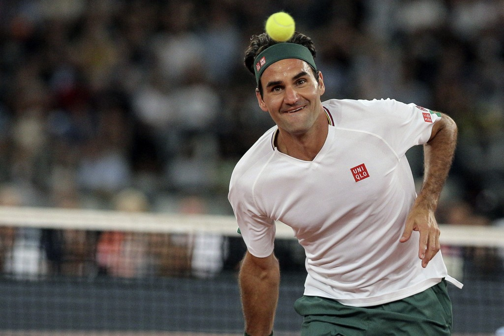 Roger Federer in action during the exhibition tennis match against Rafael Nadal held at the Cape Town Stadium in Cape Town, South Africa, Friday Feb. ...