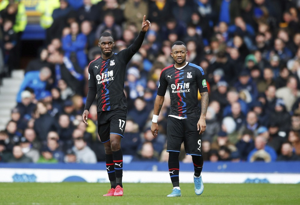 Crystal Palace's Christian Benteke, left, celebrates scoring his side's first goal of the game against Everton, with Jordan Ayew during their English ...