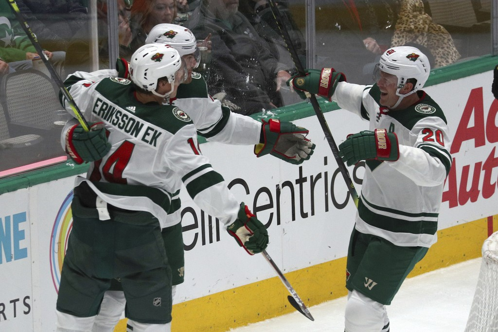 Minnesota Wild left wing Marcus Foligno (17), center Joel Eriksson Ek (14) and defenseman Ryan Suter (20) celebrate a second-period goal by Foligno du...
