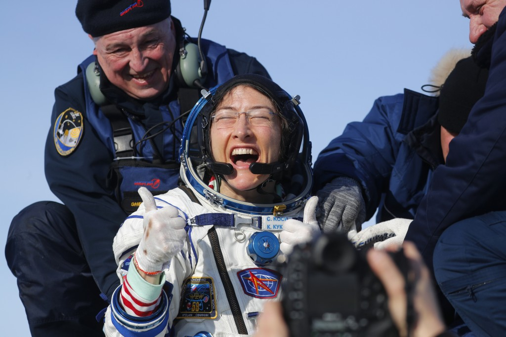 U.S. astronaut Christina Koch gives a thumbs up shortly after the landing of the Russian Soyuz MS-13 space capsule about 150 kilometrs (80 miles) sout...