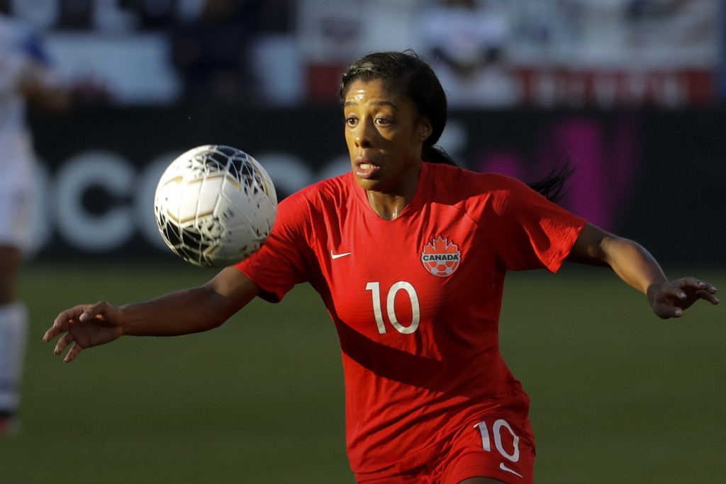 Canada defender Ashley Lawrence brings the ball downfield during the first half of a CONACAF women's Olympic qualifying soccer match against Costa Ric