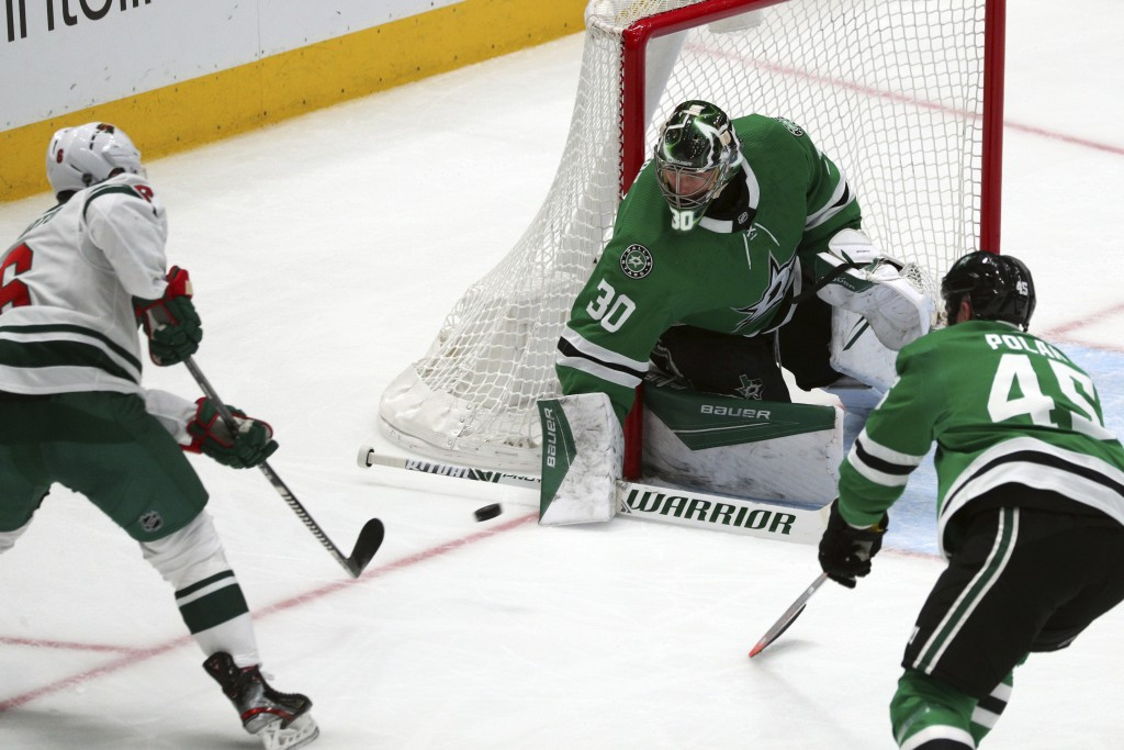 Minnesota Wild center Ryan Donato (6) shoots against Dallas Stars goaltender Ben Bishop (30) in the second period during an NHL hockey game Friday, Fe...