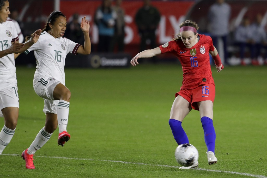U.S. midfielder Rose Lavelle, right, scores past Mexico midfielder Karla Nieto during the first half of a CONCACAF women's Olympic qualifying soccer m...