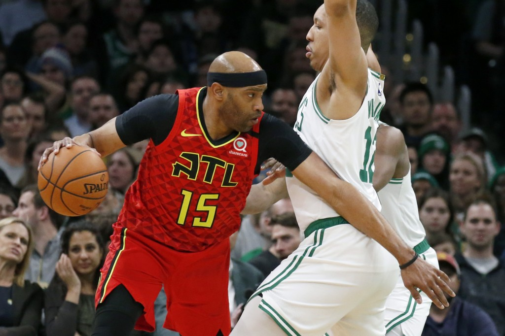 Atlanta Hawks' Vince Carter (15) drives against Boston Celtics' Grant Williams (12) during the first half of an NBA basketball game Friday, Feb. 7, 20...
