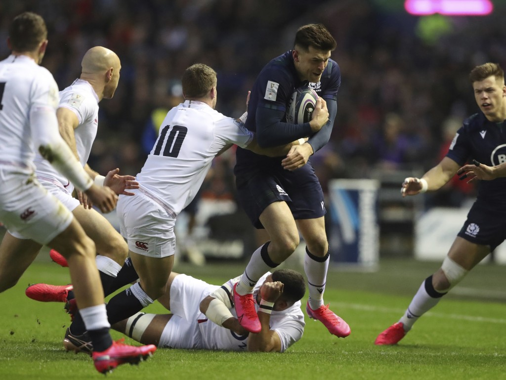 England's George Ford, 10, tackles Scotland's Blair Kinghorn during the Six Nations rugby union international match between Scotland and England at Mu...
