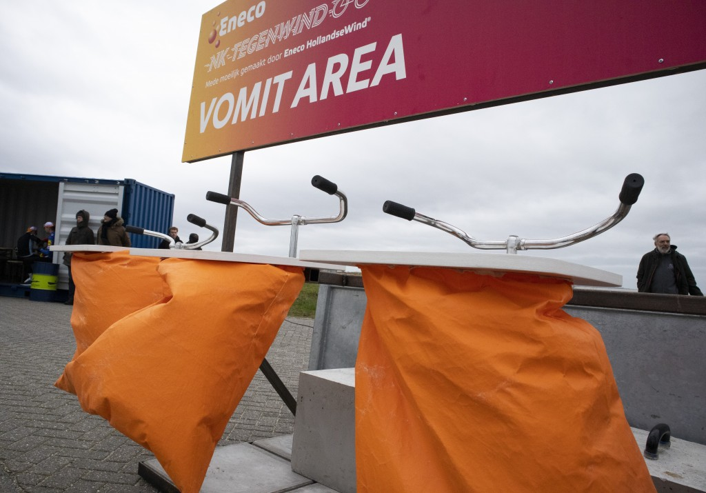 Bicycle handle bars serves as support over a bucket at the vomit area on the finish line of the Dutch Headwind Cycling Championships on the storm barr...