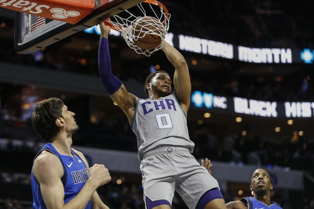 CORRECTS ID TO BOBAN MARJANOVIC NOT KRISTAPS PORZINGIS Charlotte Hornets forward Miles Bridges (0) dunks as Dallas Mavericks forward Boban Marjanovic,...