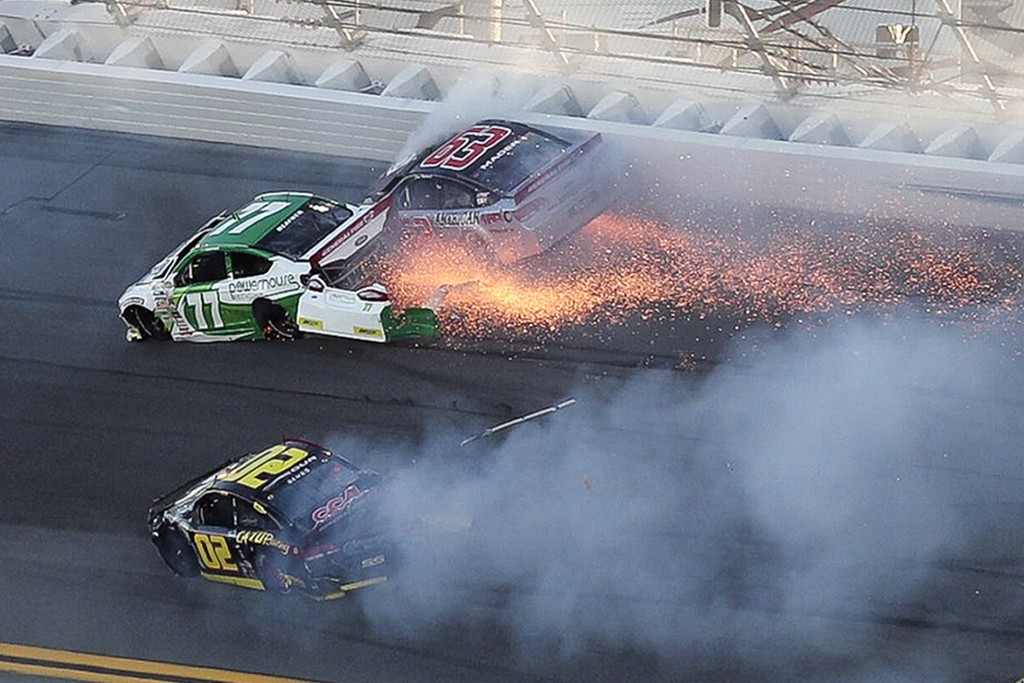 Jacob Heafner (77), Dave Mader III (63) and Andy Seuss (02) wreck in Turn 1 during the ARCA series auto race at Daytona International Speedway, Saturd...