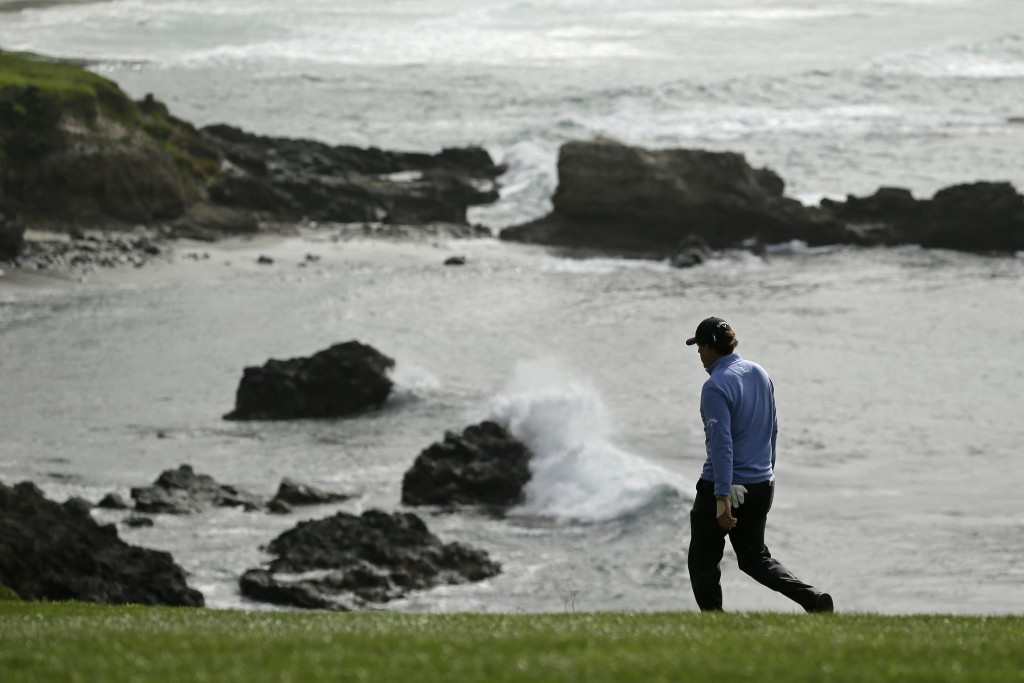 Phil Mickelson walks down the fairway to the eighth green of the Pebble Beach Golf Links during the third round of the AT&T Pebble Beach National Pro-...