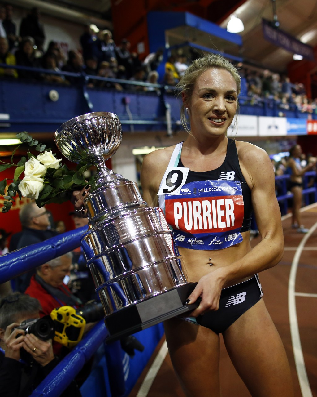 Elle Purrier holds a trophy after winning the NYRR Wanamaker Mile at the Millrose Games track and field meet Saturday, Feb. 8, 2020, in New York. (AP ...