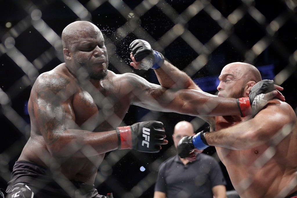 Derrick Lewis, left, takes a punch from Ilir Latifi during a heavyweight mixed martial arts bout at UFC 247 on Saturday, Feb. 8, 2020, in Houston. (AP...