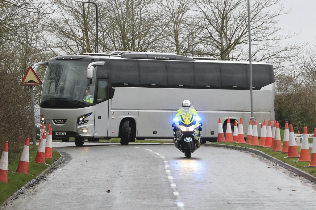 Coaches carrying people who have recently flown back from China arrive at Kents Hill Park Training and Conference Centre, in Milton Keynes, England, S...