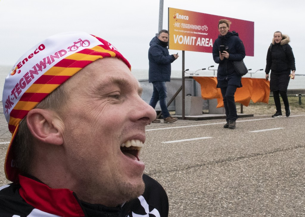 Wouter de Jonge catches his breath in the vomit area after battling gale force winds during the Dutch Headwind Cycling Championships on the storm barr...