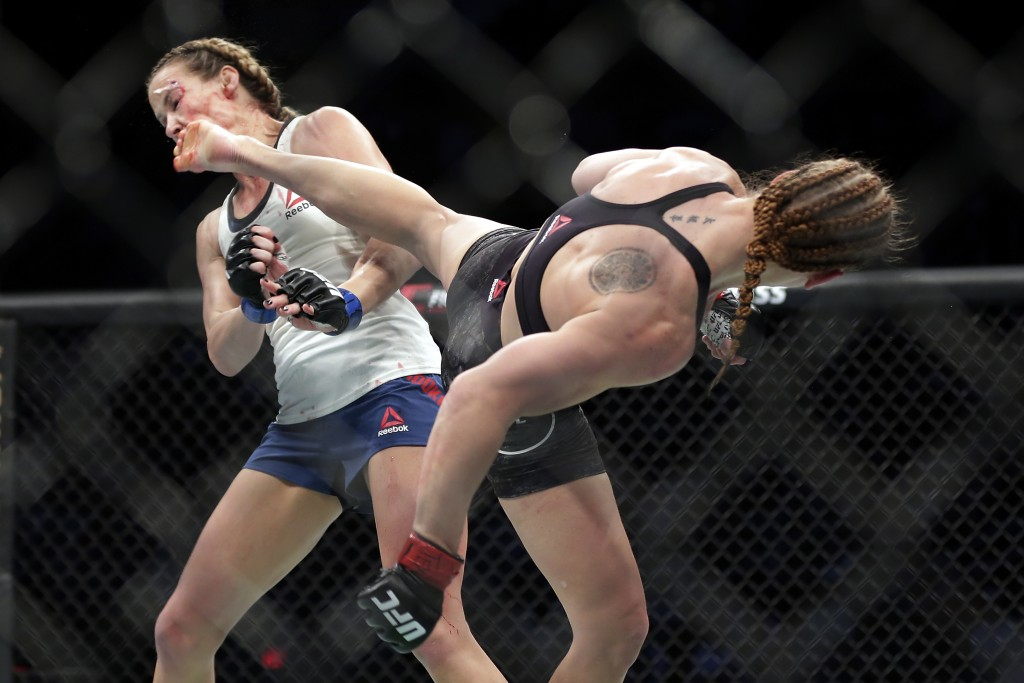 Valentina Shevchecko, right, lands a heel kick to Katlyn Chookagian's face during a women's flyweight mixed martial arts bout at UFC 247 on Saturday, ...