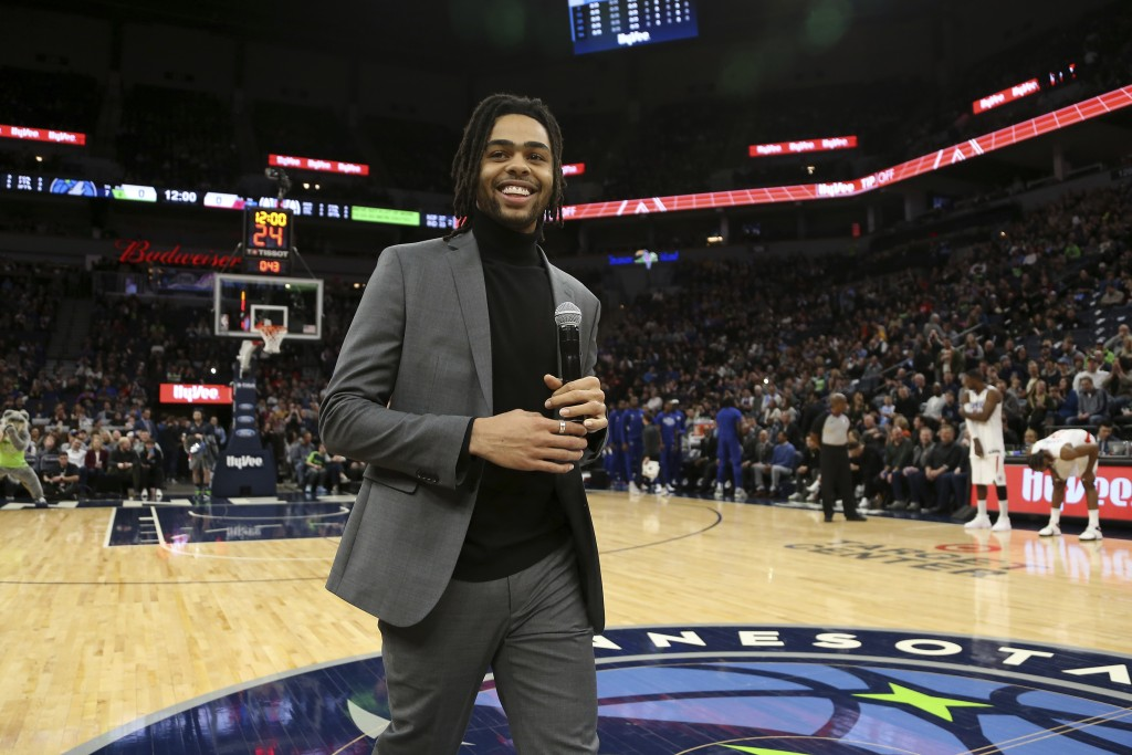 Minnesota Timberwolves' D'Angelo Russell smiles after addressing team fans prior to an NBA basketball game against the Los Angeles Clippers, Saturday,...