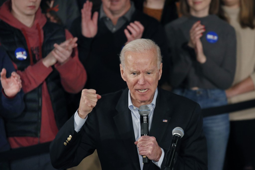 Democratic presidential candidate former Vice President Joe Biden clenches his fist as he speaks at a campaign event, Saturday, Feb. 8, 2020, in Manch...