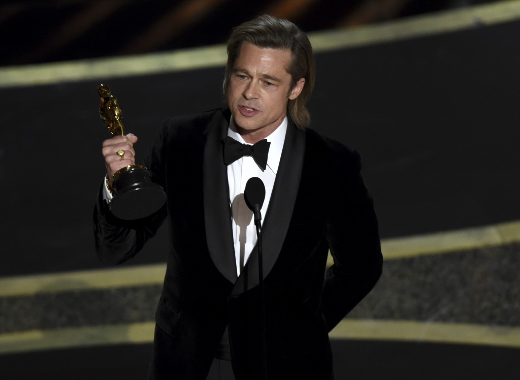 "Brad Pitt accepts the award for best performance by an actor in a supporting role for ""Once Upon a Time in Hollywood"" at the Oscars on Sunday, Feb. 9,..."