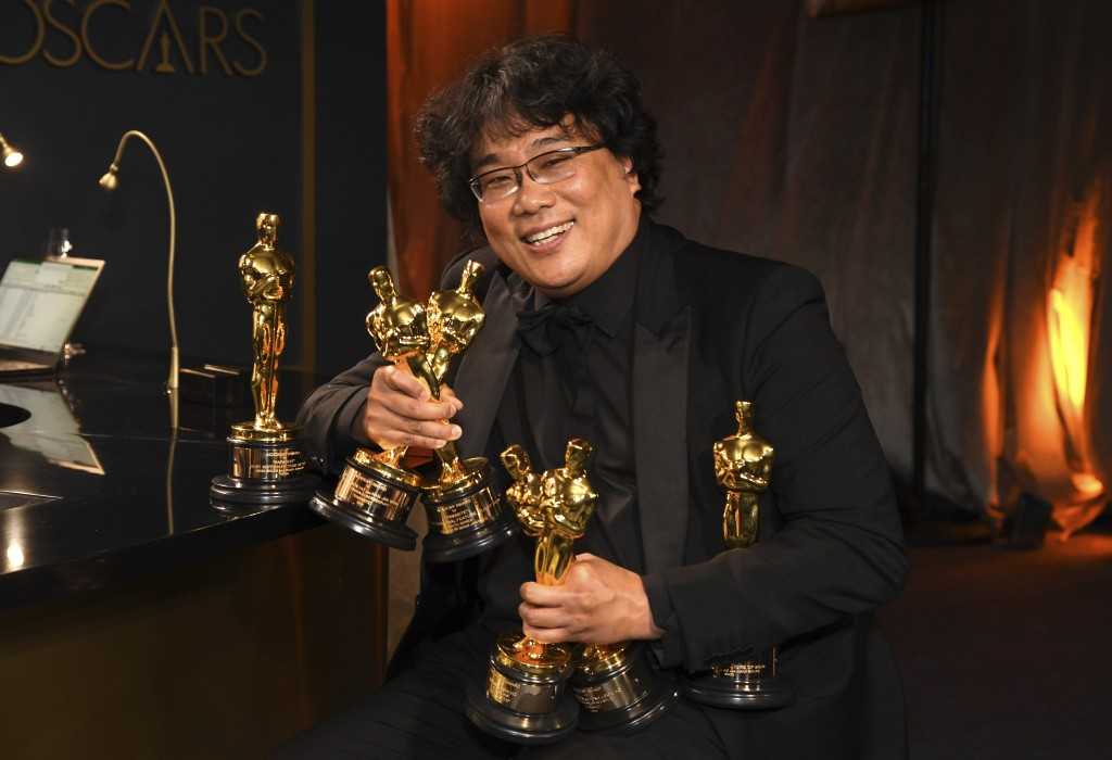 "Bong Joon-ho holds the Oscars for best original screenplay, best international feature film, best directing, and best picture for ""Parasite"" at the Go..."