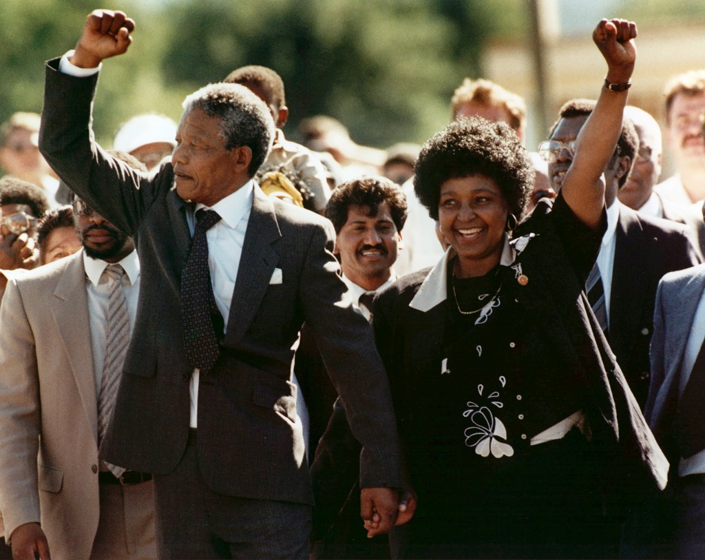 FILE - In this Feb. 11, 1990 file photo, Nelson Mandela and his wife, Winnie Madikizela-Mandela, gesture as Mandela walks free from the Victor Verster...