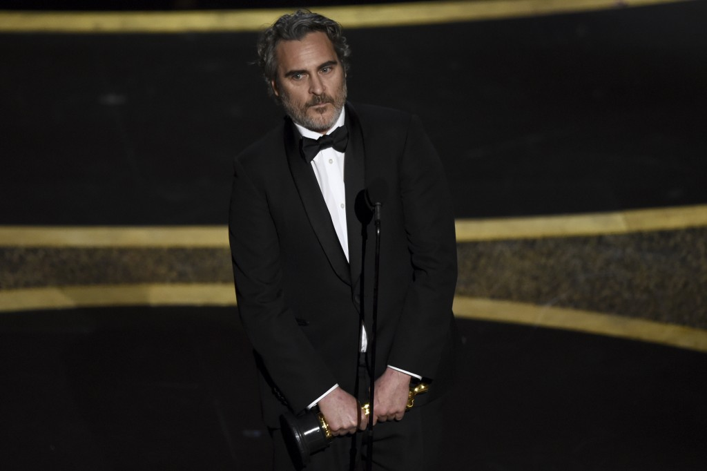 "Joaquin Phoenix accepts the award for best performance by an actor in a leading role for ""Joker"" at the Oscars on Sunday, Feb. 9, 2020, at the Dolby T..."
