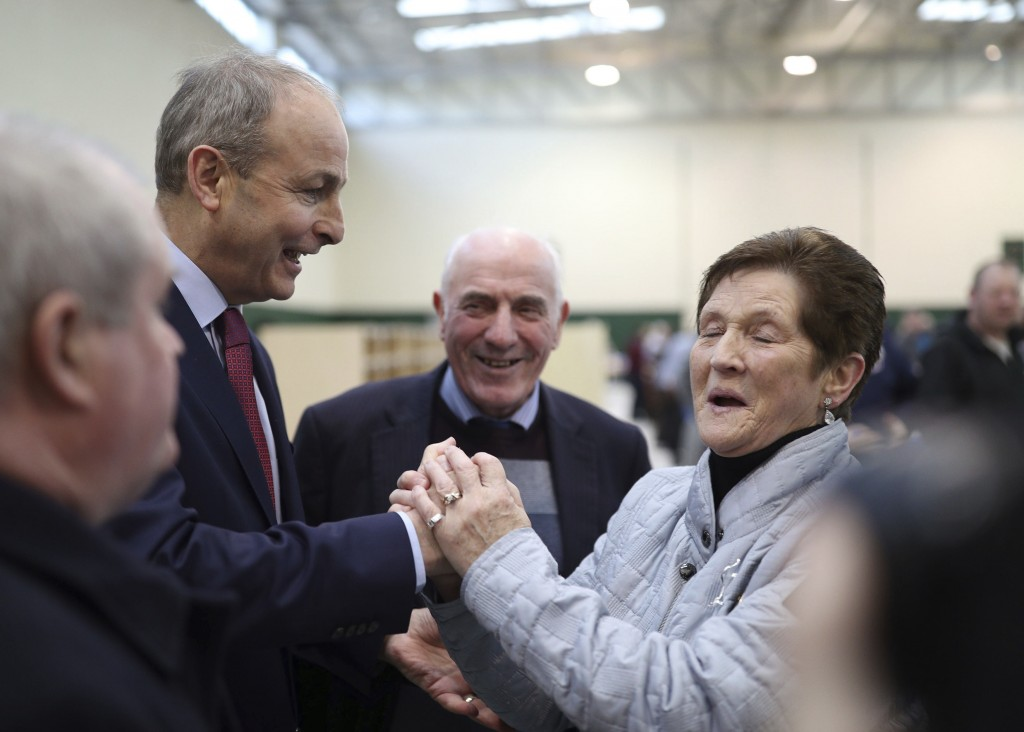 Fianna Fail leader Micheal Martin is greeted by a supporter during the Irish General Election count at Nemo Rangers GAA Club in Cork., Ireland, Sunday...