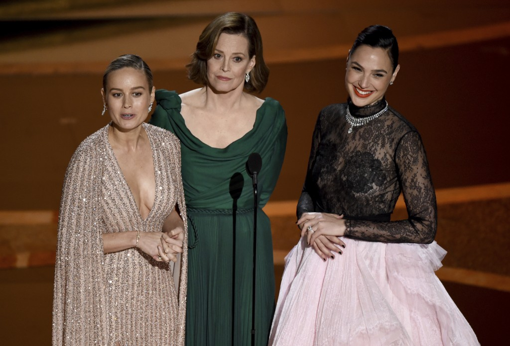 Brie Larson, from left, Sigourney Weaver and Gal Gadot introduce a performance by maestro Eimear Noone at the Oscars on Sunday, Feb. 9, 2020, at the D...