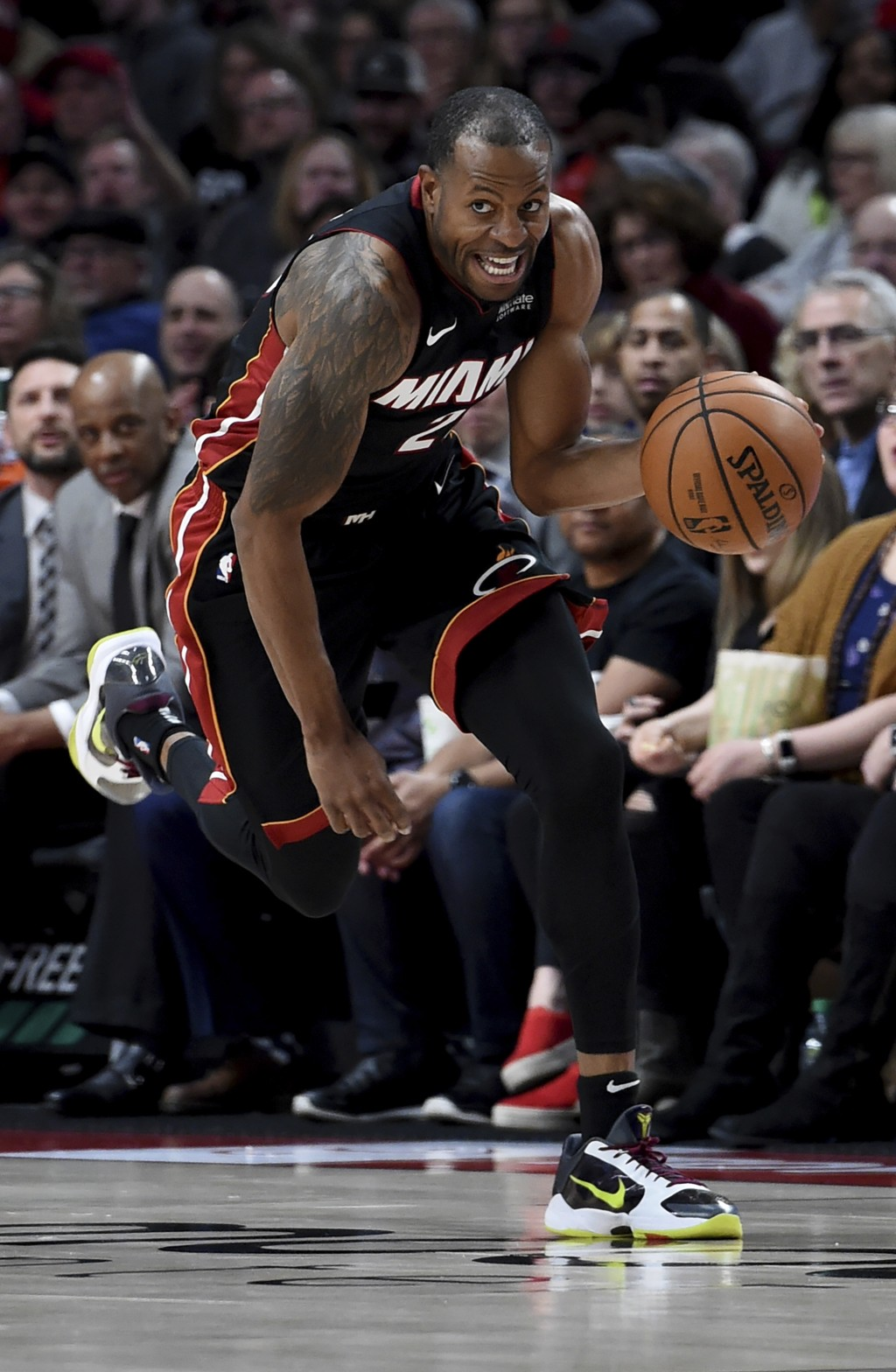 Miami Heat guard Andre Iguodala brings the ball up the court during the first half of an NBA basketball game against the Portland Trail Blazers in Por...
