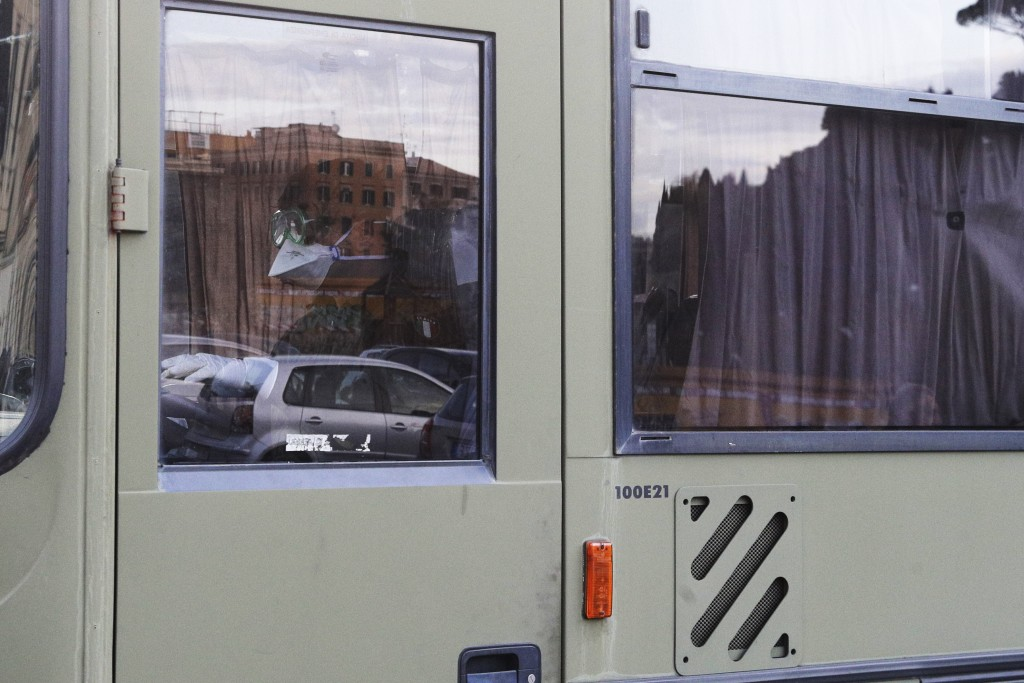 Italians evacuated from Wuhan, China, on a military bus arrive at an army complex in Rome, Sunday, Feb. 9, 2020. The Italian foreign ministry said the...