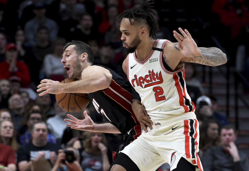 Portland Trail Blazers guard Gary Trent Jr. right, fouls Miami Heat guard Goran Dragic, left, as the go after a ball during the first half of an NBA b...