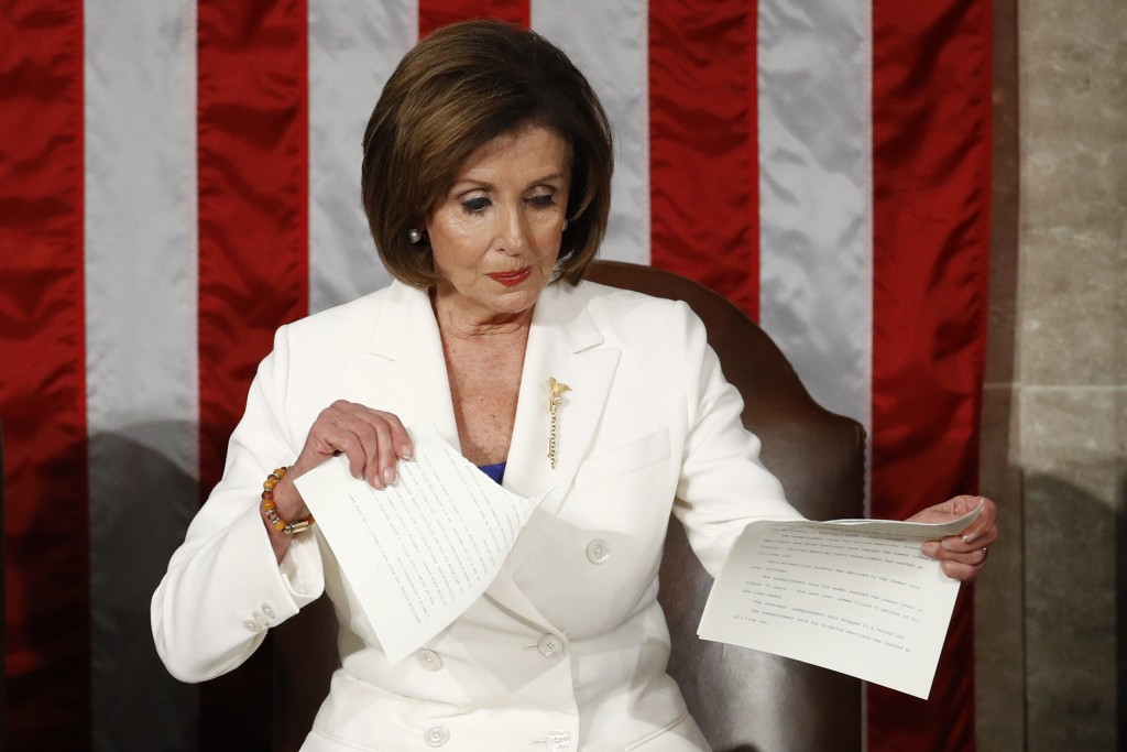 FILE - In this Tuesday, Feb. 4, 2020, file photo, House Speaker Nancy Pelosi, of California, tears her copy of President Donald Trump's State of the U...