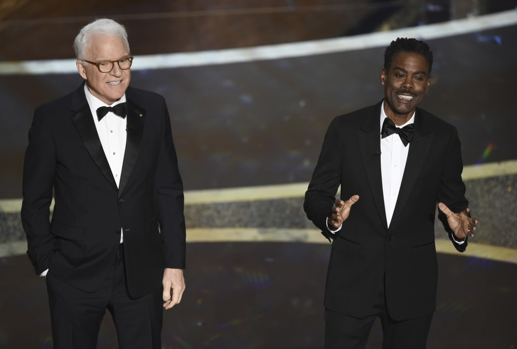 Steve Martin, left, and Chris Rock speak at the Oscars on Sunday, Feb. 9, 2020, at the Dolby Theatre in Los Angeles. (AP Photo/Chris Pizzello)