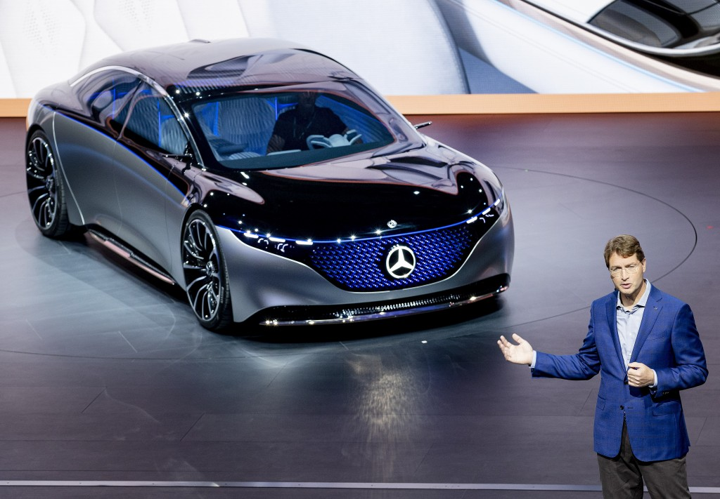 FILE - In this Tuesday, Sept. 10, 2019 file photo Ola Kaellenius, CEO of the car manufacturer Mercedes, stands next to a 'Vision EQS' car at the IAA A...