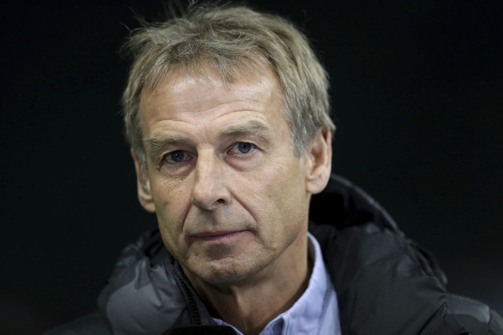 In this Saturday, Dec. 21, 2019 photo Hertha's head coach Juergen Klinsmann listens to a reporter's question during an interview prior to the German B...