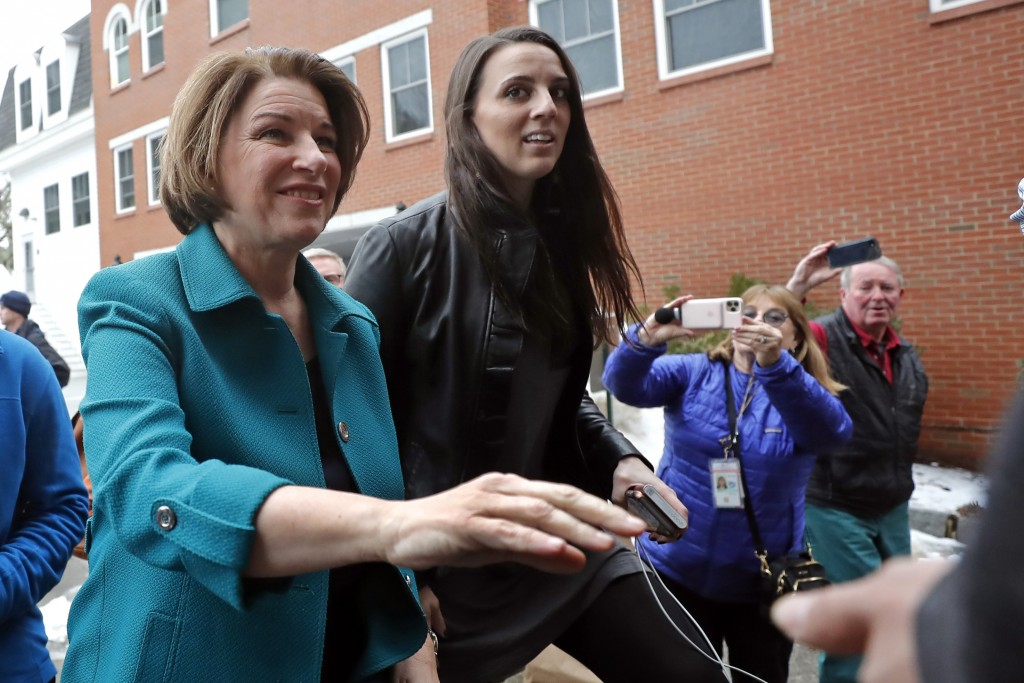 Democratic presidential candidate Sen. Amy Klobuchar, D-Minn., walks to a campaign event, Monday, Feb. 10, 2020, in Exeter, N.H. (AP Photo/Elise Amend...