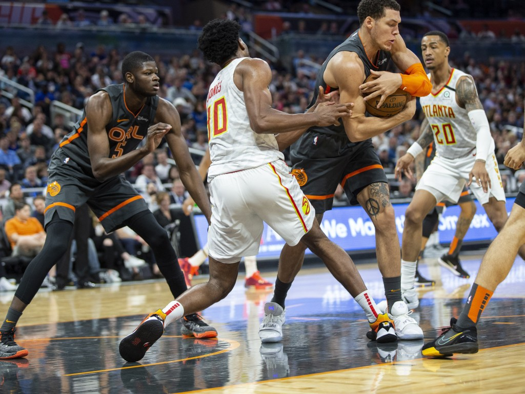 Orlando Magic forward Aaron Gordon (00) fights for the ball with Atlanta Hawks center Damian Jones (30) and forward John Collins (20) during the first...