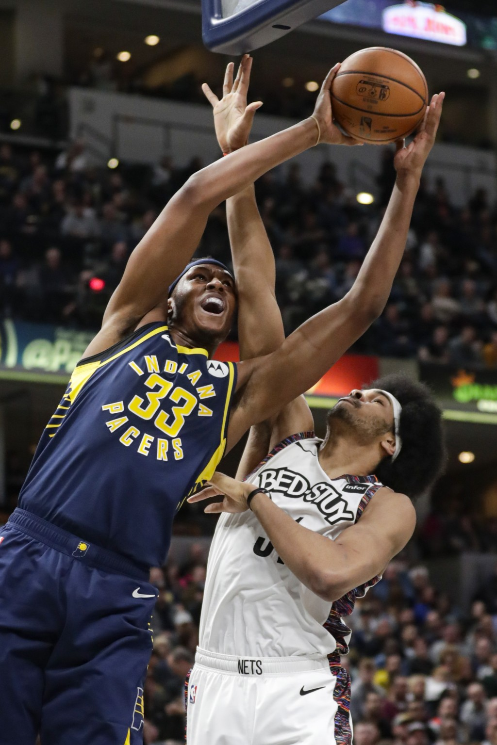 Indiana Pacers center Myles Turner (33) is fouled by Brooklyn Nets center Jarrett Allen (31) while shooting during the first half of an NBA basketball...