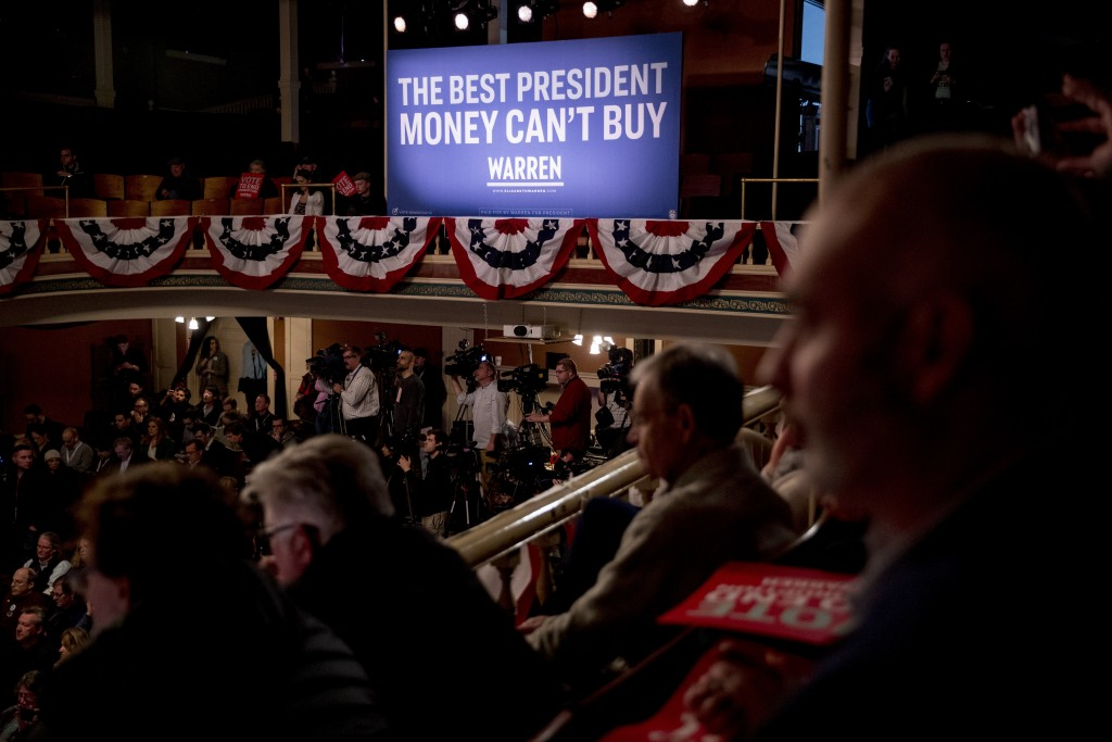 "A large poster in the back of the room reads ""The Best President Money Can't Buy"" as Democratic presidential candidate Sen. Elizabeth Warren, D-Mass.,..."