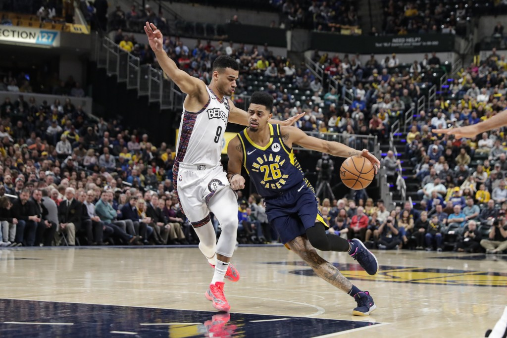 Indiana Pacers guard Jeremy Lamb (26) drives against Brooklyn Nets guard Chris Chiozza (9) during the first half of an NBA basketball game in Indianap...
