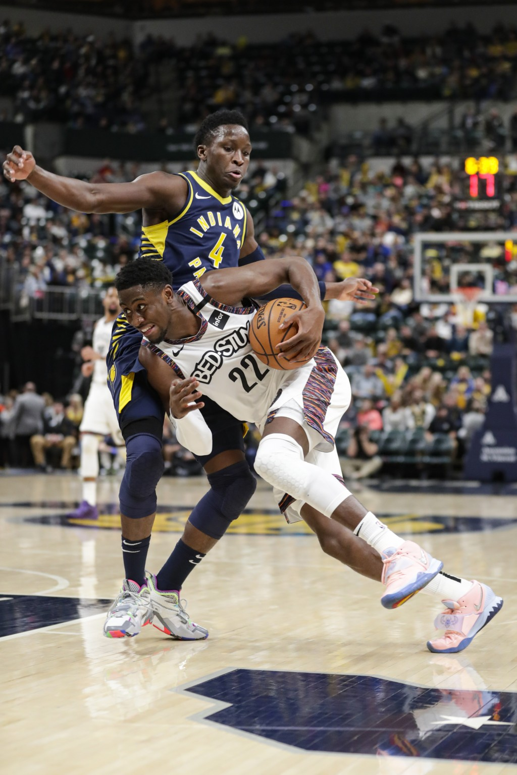 Brooklyn Nets guard Caris LeVert (22) drives against Indiana Pacers guard Victor Oladipo (4) during the second half of an NBA basketball game in India...
