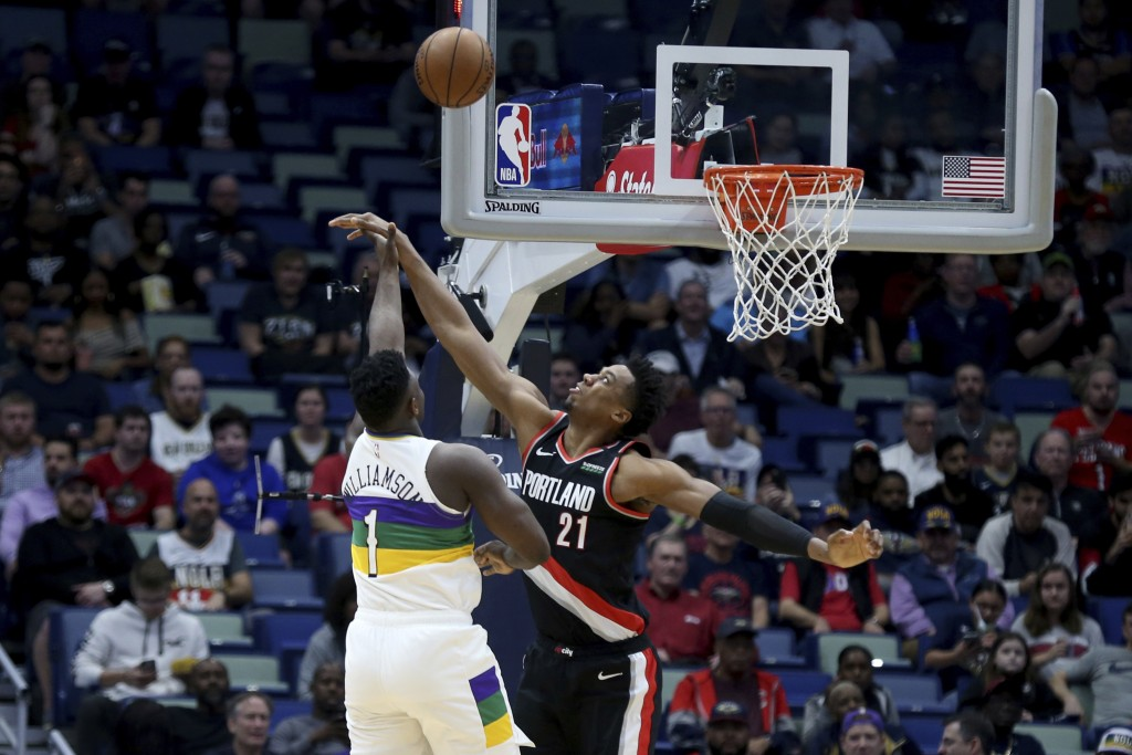New Orleans Pelicans forward Zion Williamson (1) shoots as Portland Trail Blazers center Hassan Whiteside (21) defends in the first half of an NBA bas...