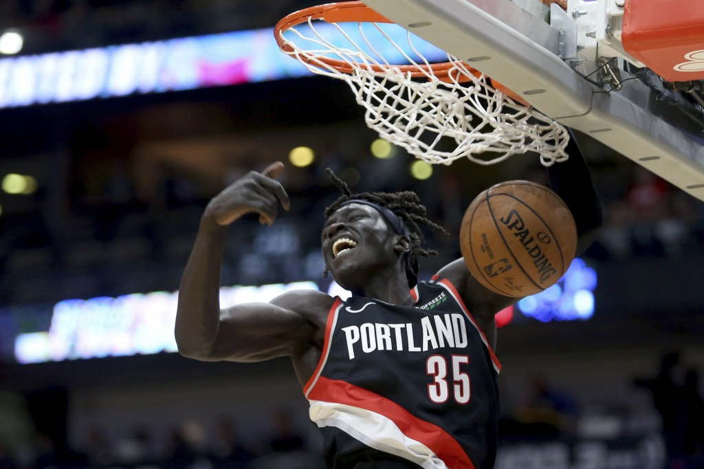 Portland Trail Blazers forward Wenyen Gabriel (35) dunks against the New Orleans Pelicans in the first half of an NBA basketball game in New Orleans, ...