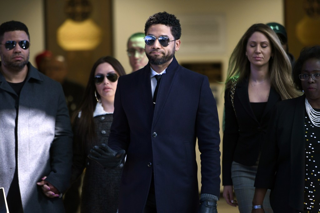 FILE - In this March 26, 2019 file photo, actor Jussie Smollett gestures as he leaves Cook County Court after his charges were dropped in Chicago.  Sm...