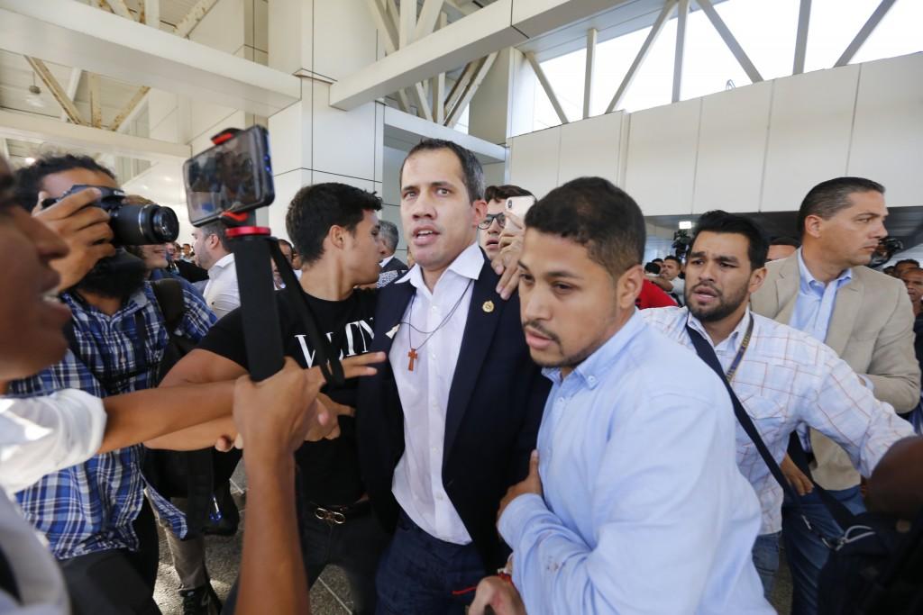 Opposition leader Juan Guaido arrives to the Simon Bolivar International Airport in La Guaira, Venezuela, Tuesday, Feb. 11, 2020. Guaido returned home...