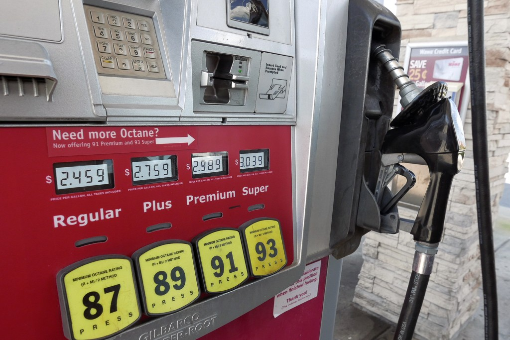 FILE - In this Sept. 17, 2019, file photo, a gas pump reflecting current prices is seen in Orlando, Fla. On Thursday, Feb. 13, 2020, the Labor Departm...