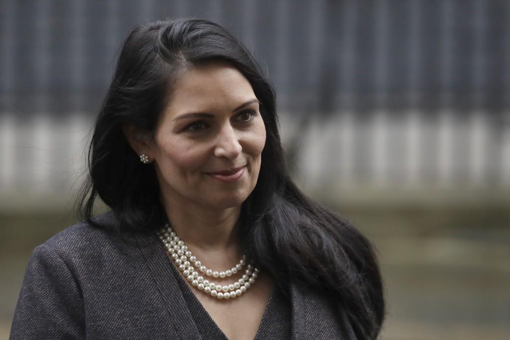 British Lawmaker Priti Patel, the Home Secretary leaves 10 Downing Street in London, Thursday, Feb. 13, 2020. British Prime Minister Boris Johnson sho...