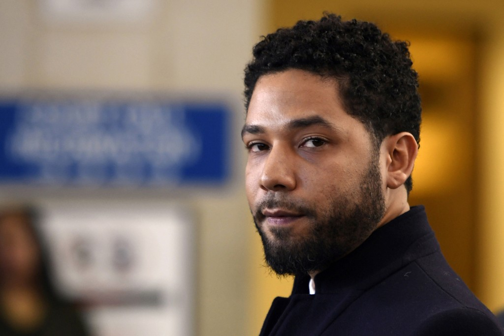 FILE - In this March 26, 2019, file photo, actor Jussie Smollett talks to the media before leaving Cook County Court after his charges were dropped in...