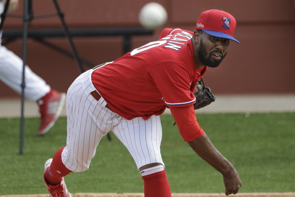 Philadelphia Phillies' Reggie McClain delivers a pitch during a spring training baseball workout Friday, Feb. 14, 2020, in Clearwater, Fla. (AP Photo/...