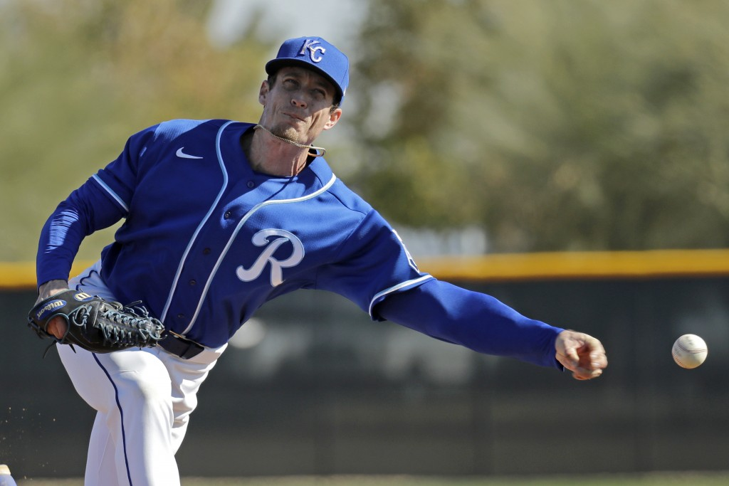 Kansas City Royals relief pitcher Tim Hill throws during baseball spring training Sunday, Feb. 16, 2020, in Surprise, Ariz. (AP Photo/Charlie Riedel)